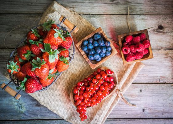 37375673 - berries on wooden background