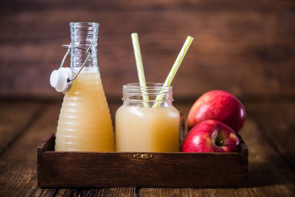 62056541 - apple cold pressed juice and fruits in wooden box